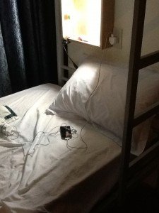 Hostel bunk bed living - listening to downloads on headphones is easy