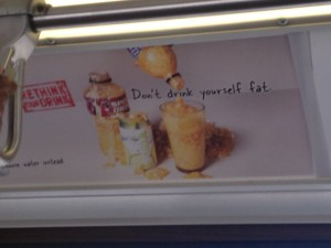 This poster on a bus in Hawaii. Soda is a huge problem due to corn syrup